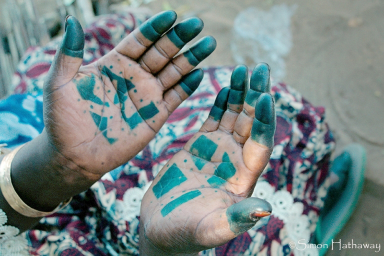 Senegalese lady with traditionally decorated hands.. Image shot 2004. Exact date unknown.